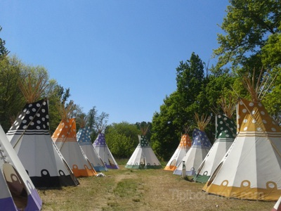 A camp of 18 tepees in France. They have been manufactured for company Sleep 'em' All from Portugal