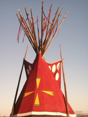 The upper part of the Otter Teepee. A painting that represents The Morning Star.