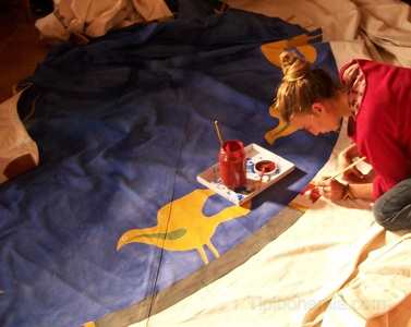 Andrea painting the cover of the Dream Cutcher Teepee.