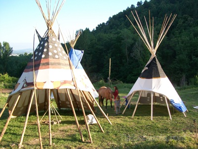 Teepees with the covers rolled up.