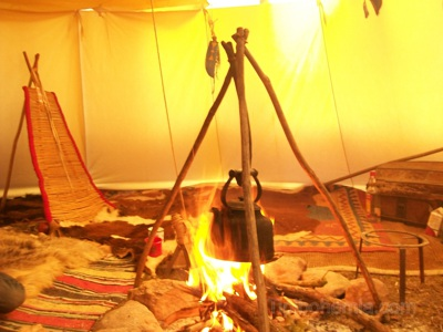 Interior with fire and cooking tripod.