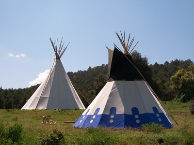 A teepee of 4m in the foreground and in the background one of 10m.