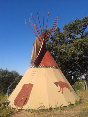 The Magic of the Bear teepee, made with beige canvas.